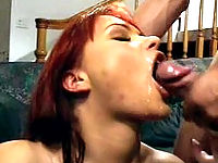 Redhead vixen widely opens up her mouth to receive a dose of sticky goo.