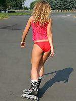 Sylphlike Iva shows her red panties outdoors