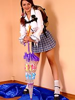 Lady in schoolgirl uniform shows panties with butterfly