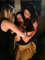 Two vicious lesbians attack and ass fuck luscious girl.