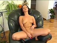 cute brunette fuckingg herself with golden dildo