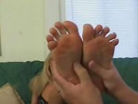 Blonde gets erotic foot massage and toe sucked