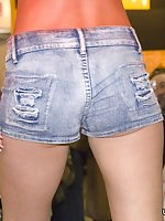 Two frisky girls in cowboy hats slap asses in jeans shorts