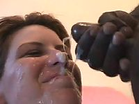 Kinky brunette older woman enjoying the warm cum spread all over her face