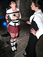 Girl in pigtails and school uniform in hard bondage.