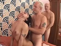 Two harsh blokes fuck TS in white stocking in orgy