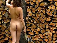 Young hottie forced to chop firewood naked