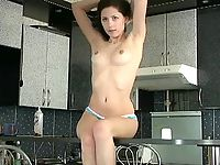 Cute amateur virgin Angel getting naked in a kitchen and playing around showing her sexy spots.
