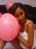 Lovely Indian girl plays with balloons