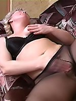 Playful blonde mom in black pantyhose masturbating