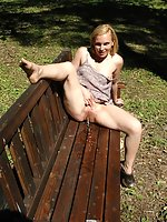 Busty blonde prankster pisses onto the park bench