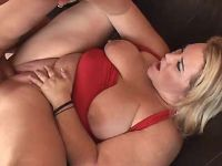 Guy fucks chubby blonde lady in red