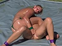 Hot ass Christina Carter and Vendetta wrestles in oil in Cabo.