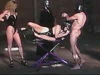 Whores in black n red latex in orgy