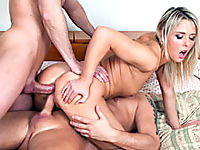 Blonde bitch with two big dicks in her mouth