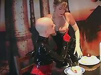Whore in latex pleases dominatrix